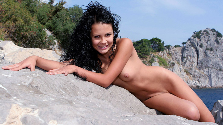 Smiling Naked Chick on a Rock