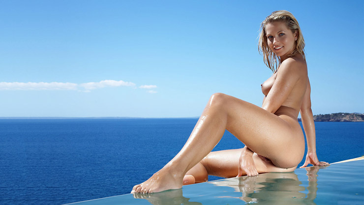 nude blond girl in infinity pool