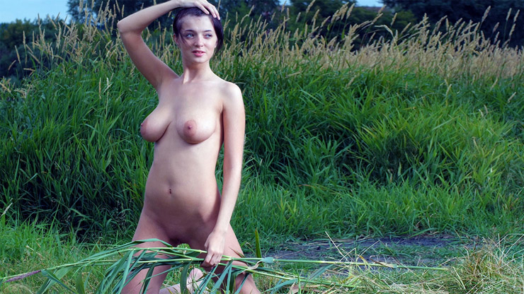 Naked girl in the grass big tits